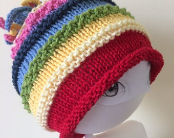 Love Rainbows:  handknit multi colored hat with curley topper and rolled brim