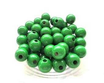 50 wooden pacifier 10mm - Green beads