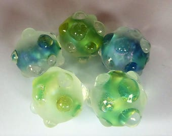 Glass lampwork bead set made with silverglass and dichro