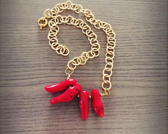 Golden chain with red coral branches