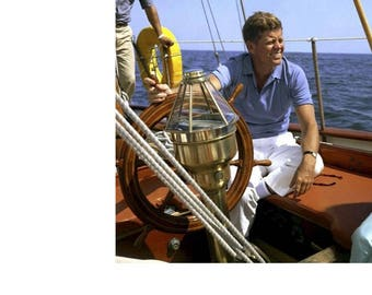 "Reproduction photo of President John F. Kennedy sailing aboard yacht ""Manitou"" August  1962"