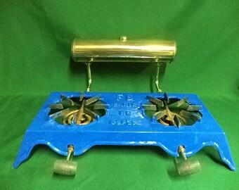 Vintage cast iron enamel alcohol double burner stove top. (ref E)