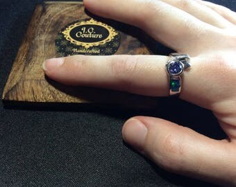 Tanzanite, Topaz, Opal Ring; A stunning statement ring. White, blue, and multi-color.