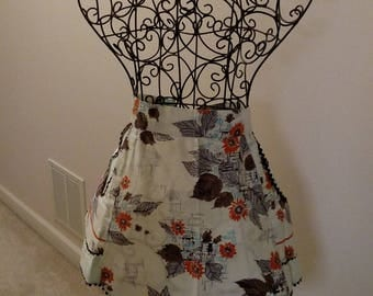 Used and worn floral with brown trim party apron