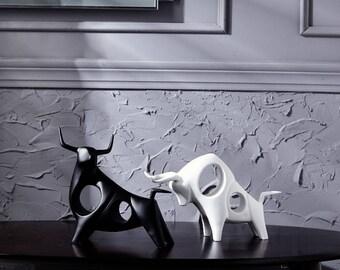 Black and white Raging Bull figurine