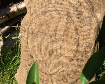 Vintage Grain Pillow Sugar original heritage pillow cover in an old jute bag
