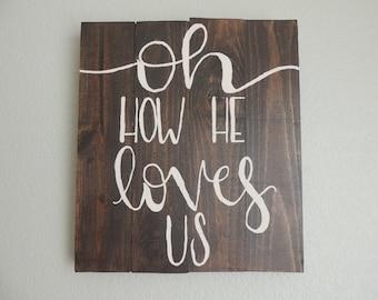 Loves Us Wooden Sign