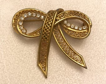 Vintage Hedy Hedison Gold Tone with Clear Rhinestones Bow Brooch