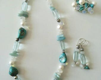 SOLD.       Turquoise, Moonstone, Blue Osilite and Fresh Water Pearl Set with matching Stirling Silver charm earrings and hand woven ring.