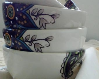 Set of four hand painted vintage bowls