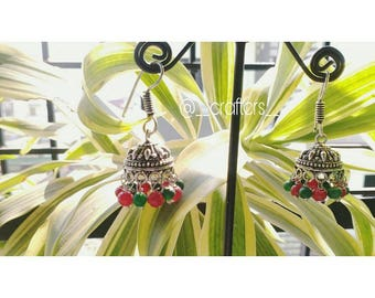 Red and green German silver jhumkas