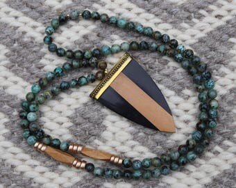 Long beaded African turquoise necklace with arrow pendant