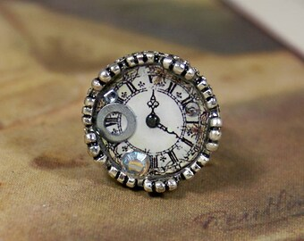 Resin ring with metal silver color with an illustration of watch