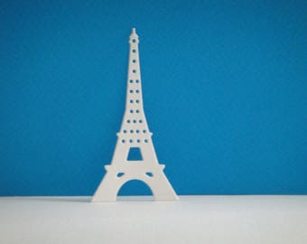 Cutting white Eiffel Tower for scrapbooking and card