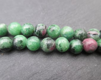 Ruby in zoisite: 10 round beads green and pink 6 mm.