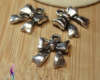 10 charms in antique silver bow charms