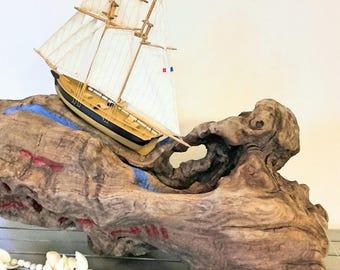 Drift wood stump and his sailboat. 30 cm