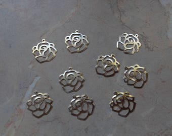 "Charms, filigree charms in silver, ""roses""."