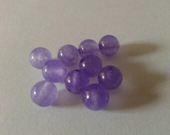 Set of 10 6mm jade beads.