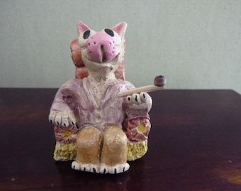 ceramic figurine: cat smoking his pipe