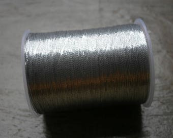 Spool of silver color 90 meters nylon polyester embroidery thread