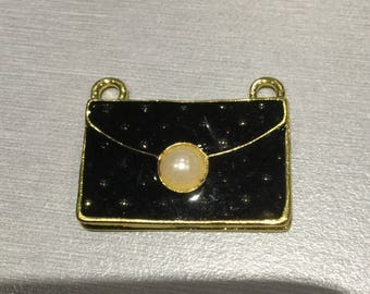 PURSE has gold black enamel
