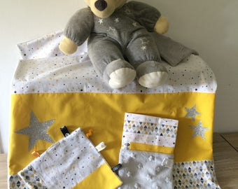 grey and yellow blanket and baby set