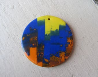 Interleave for creation - large round pendant in vivid, bright blue and bright orange yellow streaked effect mixed polymer clay