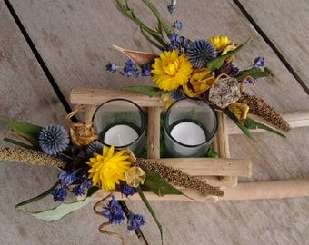Natural Driftwood candle holder shape sled arrangement in yellow and blue dried flowers immortal two candles