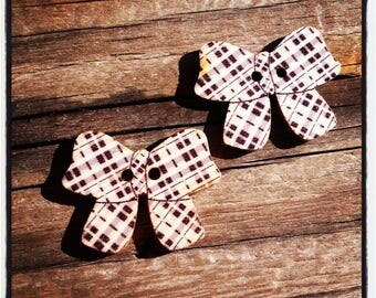 Set of 2 wooden buttons black and white bows