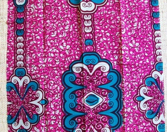 African Wax fabric in shades of pink, Burgundy and turquoise