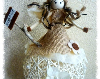 fairy with natural / flax with welcome sign