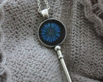 Necklace + pendant is made of resin and dried blue daisy flower