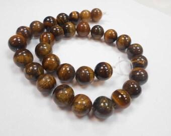 1 strand 31 beads round 12 mm Tiger eye