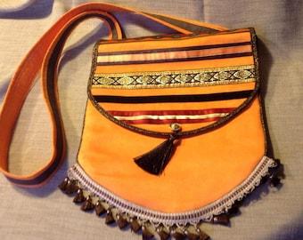 Bohemian bag orange alcantara and ribbons orange chocolate and gold.