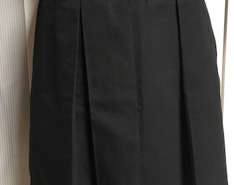 Black skirt with pleats in front and back
