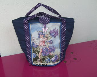 Navy blue fabric basket with an Elf and flowers