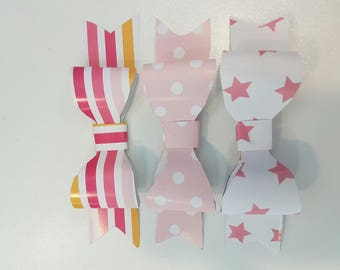 Small colorful scrapbooking paper bows