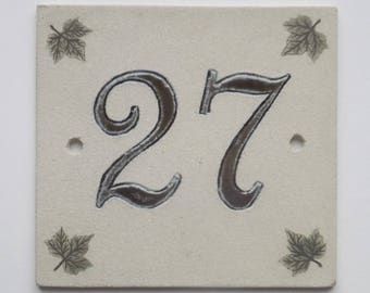 Original street number 27 in sandstone, green on ecru background, decorative leaves Ivy
