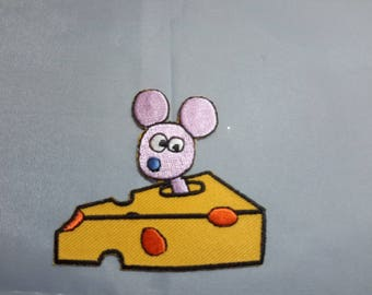 applied by iron depicting a mouse in cheese