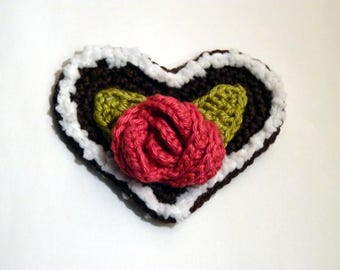 Gingerbread man with a pink crochet heart