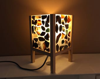 Table lamp in wood and stones