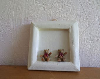 off-white frame with two brown bear