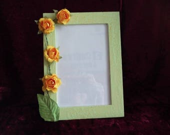 Picture frame green with yellow flowers