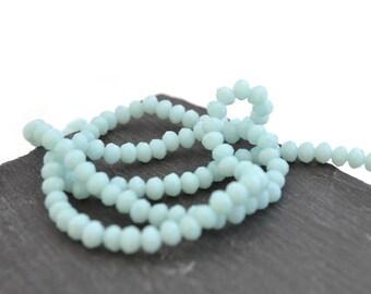100 light blue beads