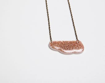 Orange/peach coloured glitter resin necklace cloud