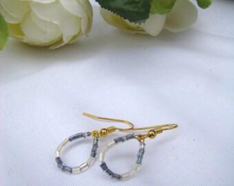 Elegant earrings in white and grey seed beads