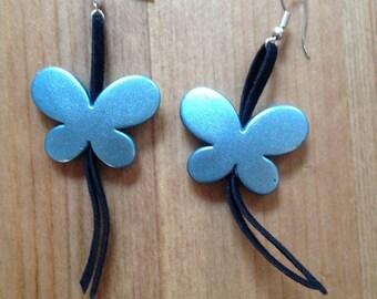 pair of metallic on black felt butterfly earrings