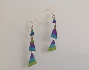 Earrings geometrical shaped ultra light shrink plastic.