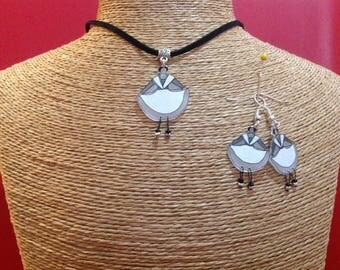 Adornment necklace and Arles with shrink plastic earrings.